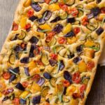 Roasted Vegetable Focaccia with a napkin.