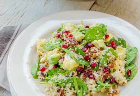 Quinoa and Spinach Salad with Roasted Cauliflower, Pecans, Avocado and Pomegranate Seeds