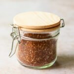 Best dry rub spice mix in a glass jar with wooden lid.